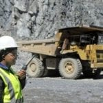 woman on the mining site with the dump truck