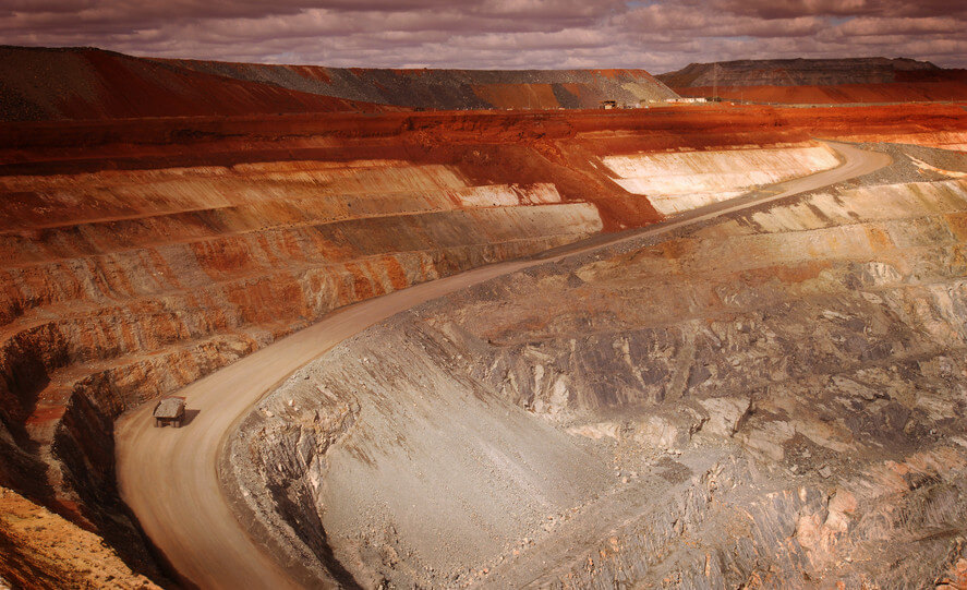 Wide angle elevated view of an open cut mine.